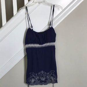 Blue tank with white embroidery detail